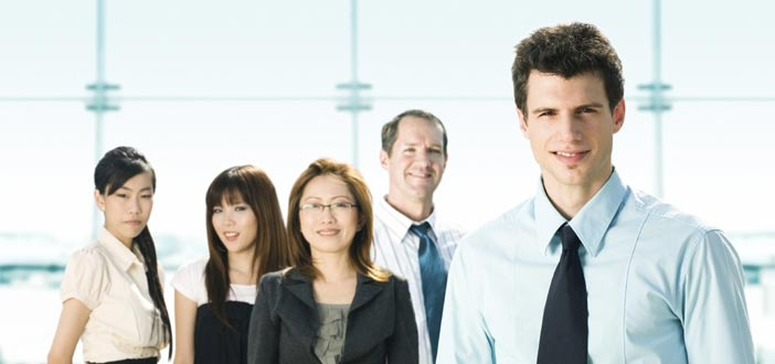 5 business professionals smiling