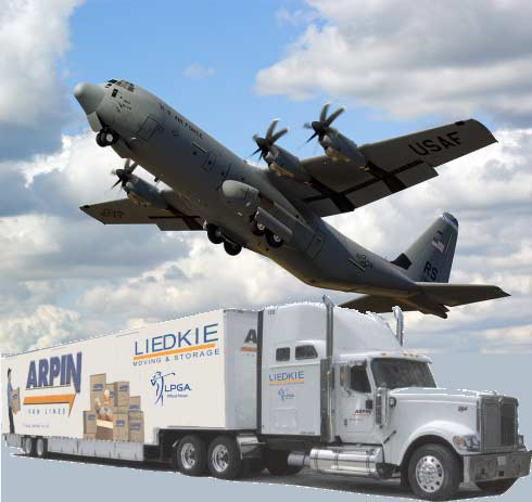Military jet flying above an Arpin/Liedkie moving truck