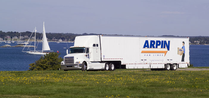 Arpin Van driving in front of lake