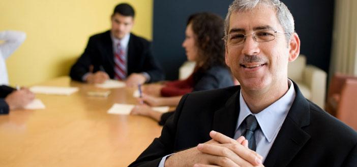 professional man smiling at corporate meeting